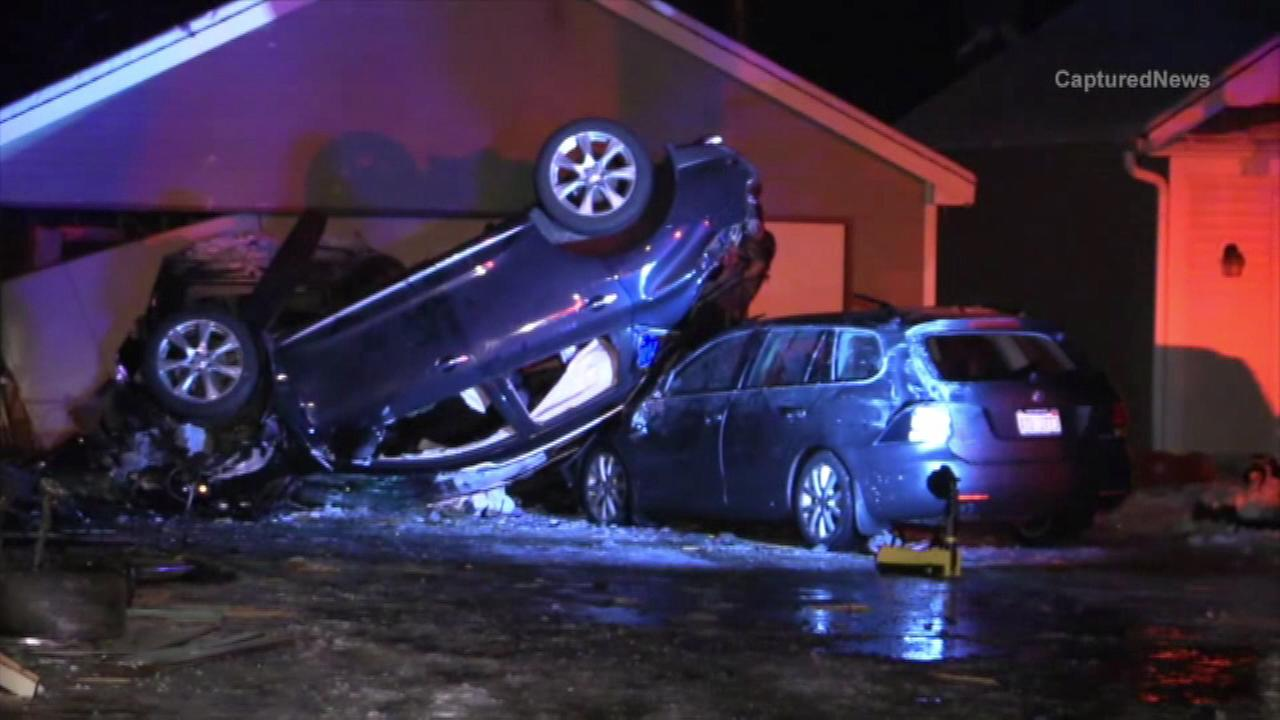 Car plows into home and flips in Batavia