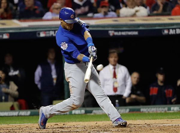 <div class='meta'><div class='origin-logo' data-origin='AP'></div><span class='caption-text' data-credit='AP Photo/David J. Phillip'>Chicago Cubs' Addison Russell hits a grand slam during the third inning of Game 6 of the Major League Baseball World Series against the Cleveland Indians Tuesday, Nov. 1, 2016.</span></div>