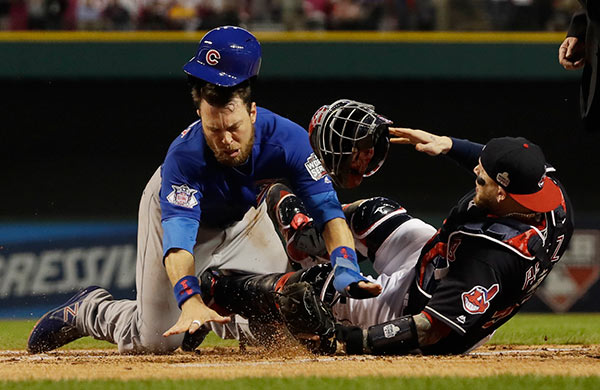 <div class='meta'><div class='origin-logo' data-origin='AP'></div><span class='caption-text' data-credit='AP Photo/David J. Phillip'>Chicago Cubs' Ben Zobrist collides with Cleveland Indians catcher Roberto Perez as he scores during the first inning of Game 6 of the Major League Baseball World Series.</span></div>