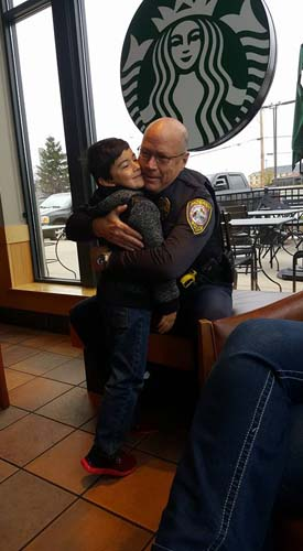 """<div class=""""meta image-caption""""><div class=""""origin-logo origin-image none""""><span>none</span></div><span class=""""caption-text"""">A police sergeant in northwest Indiana is being applauded on social media for his random act of kindness toward a young boy. (Taylor Jackson/Facebook)</span></div>"""