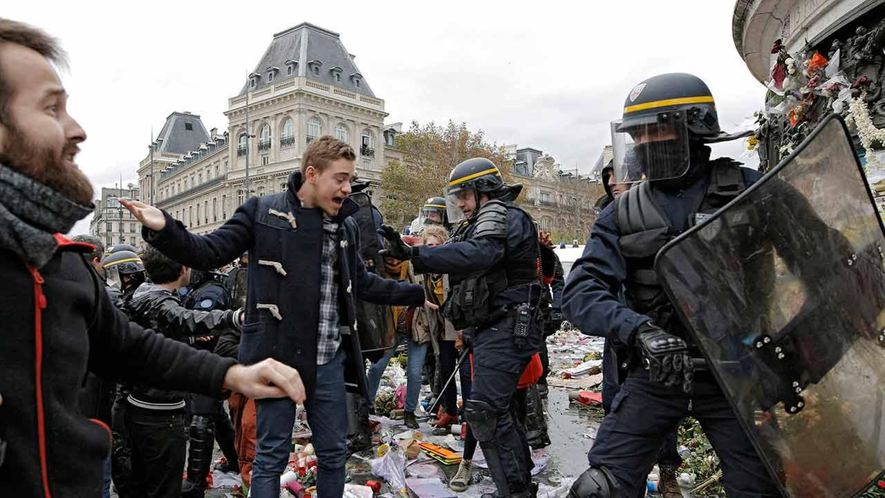Policemen fight with activists during a protest ahead of the 2015 Paris Climate Conference at the place de la Republique, in Paris on Nov. 29, 2015.