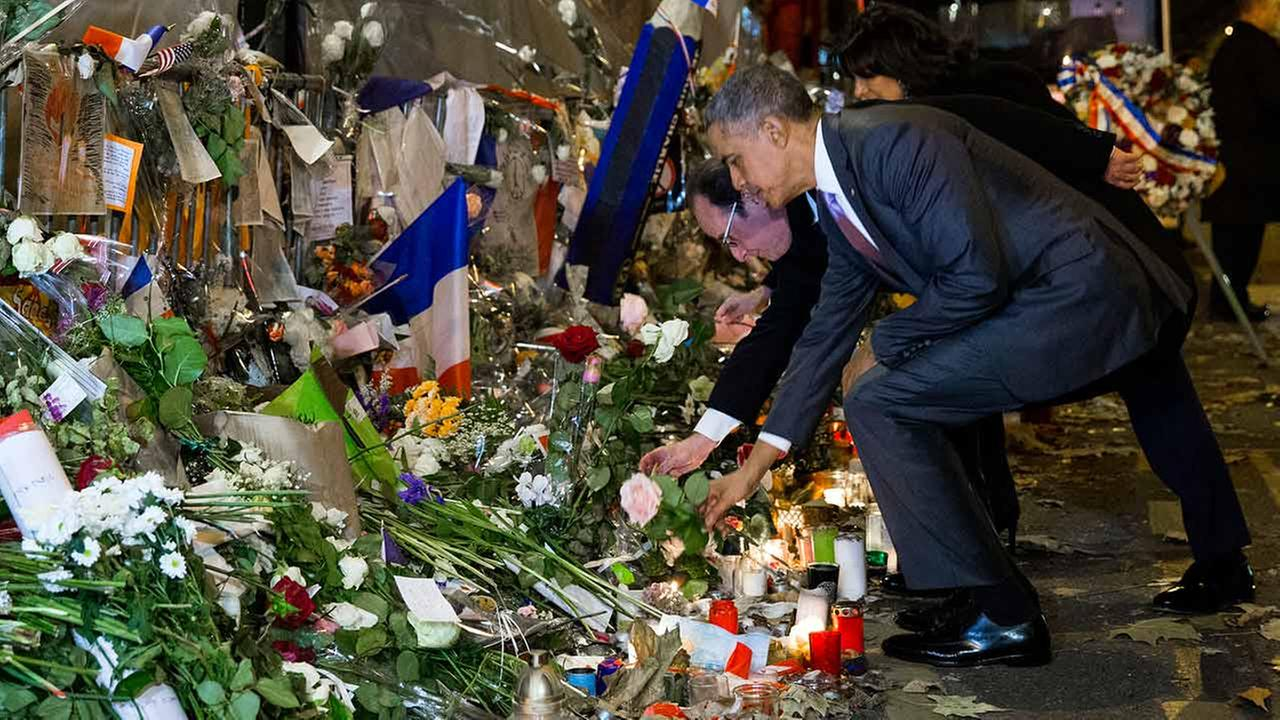 President Barack Obama, right, and French President Francois Hollande place flowers at the Bataclan, site of one of the Paris terrorists attacks.