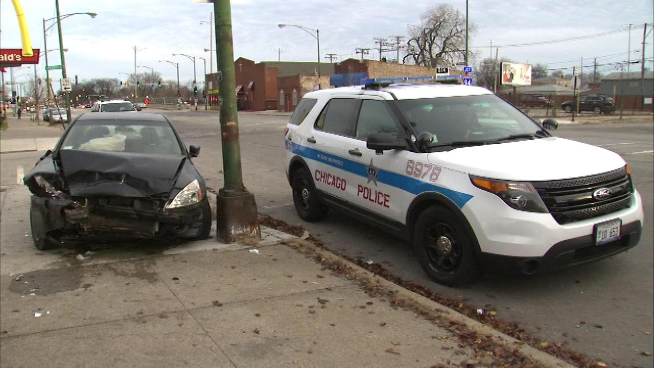 A driver crashed a stolen car and hit a Chicago police officer on the South Side Sunday afternoon.