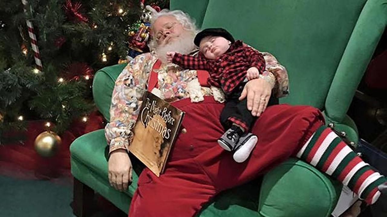In this Nov. 25, 2015 photo provided by Donnie Walters, Walters son Zeke snuggles up on Santas lap during a visit to a shopping mall in Evansville, Ind.