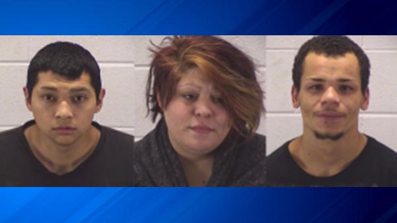 Three people have been charged and another is being sought in connection with a man who was beaten and robbed in west suburban Aurora on Thanksgiving Day.