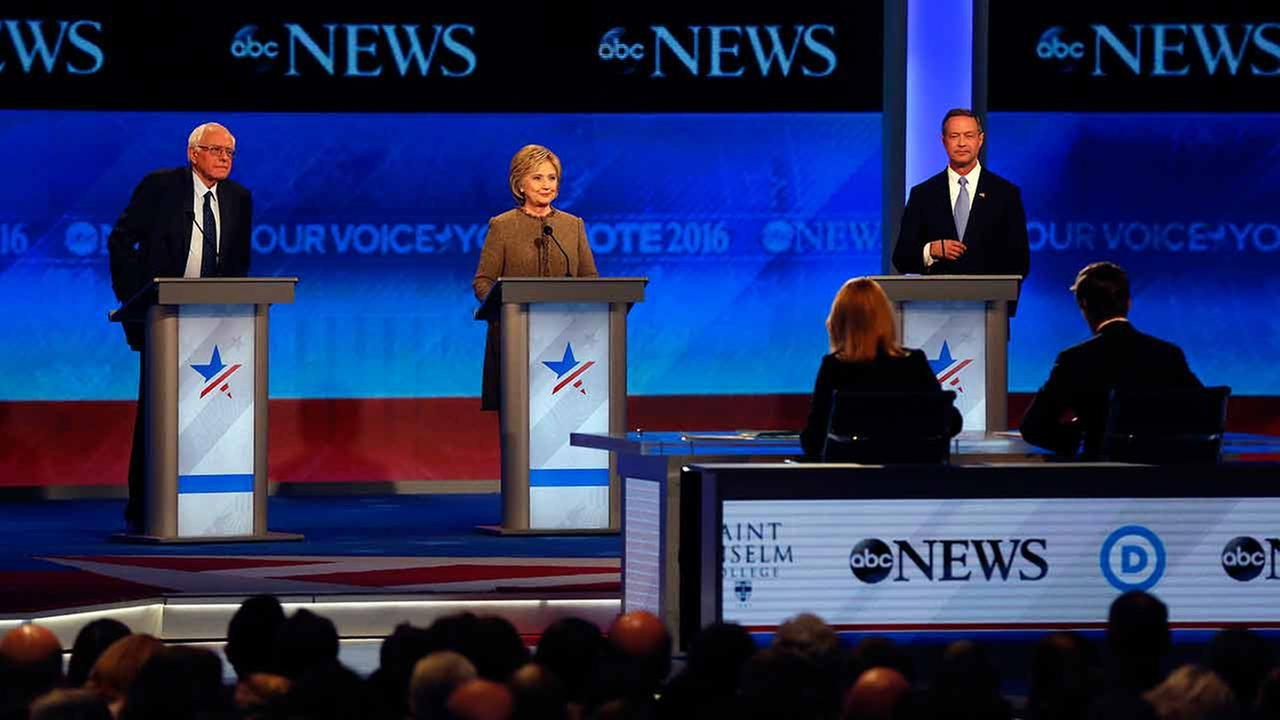 Bernie Sanders, left, Hillary Clinton, center, and Martin OMalley take the stage for a Democratic presidential primary debate Saturday, Dec. 19, 2015, at Saint Anselm College in M