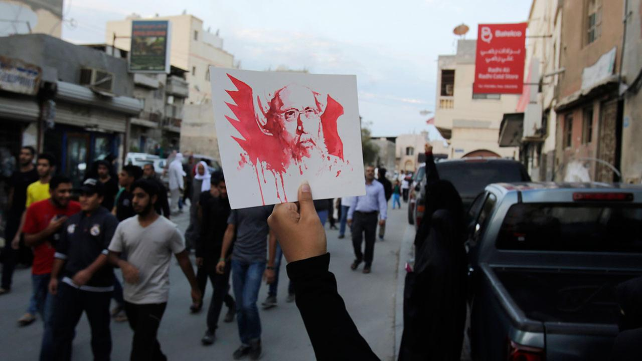 A protester holds up a picture of Saudi Shiite cleric Sheikh Nimr al-Nimr, whose execution in Saudi Arabia was announced Saturday, during a peaceful demonstrations on Jan. 2, 2015.