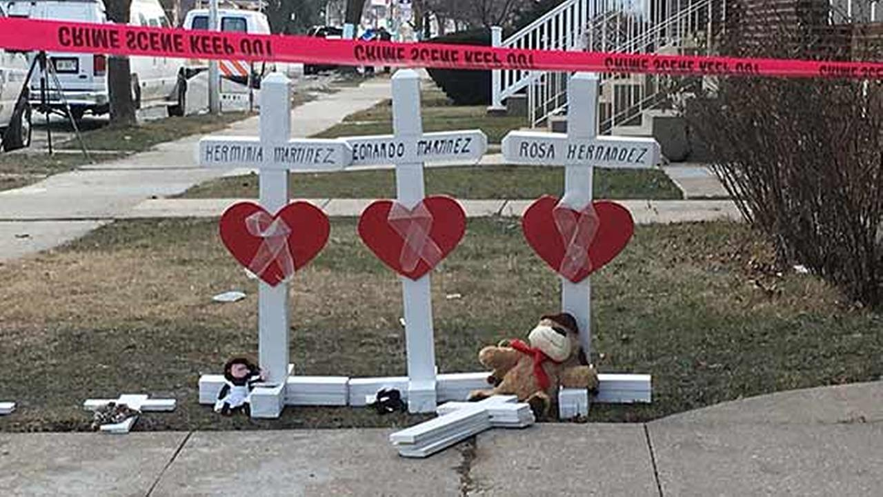 Greg Zanis, of Aurora, traveled to place six crosses, along with stuffed animals, along the sidewalk outside the Martinez home.