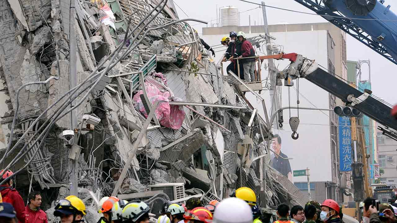 In this photo released by Chinas Xinhua News Agency, rescuers search for survivors at a quake site in Tainan, Taiwan on Feb. 6, 2016.