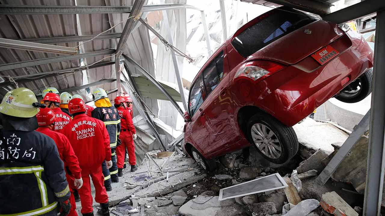 Rescue workers search a collapsed building from an early morning earthquake in Tainan, Taiwan on Feb. 6, 2016.AP Photo/Wally Santana