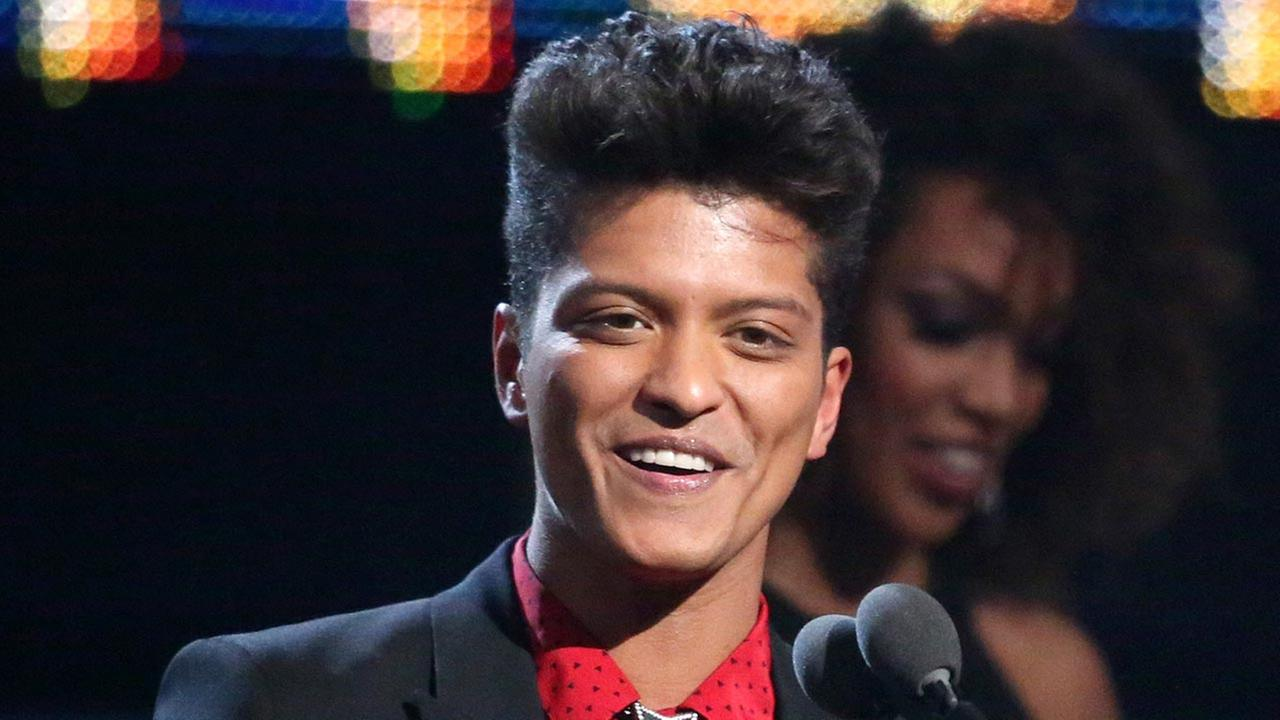 FILE - This Jan. 26, 2014 file photo shows Bruno Mars accepting the award for best pop vocal album for Unorthodox Jukebox at the 56th annual Grammy Awards in Los Angeles.
