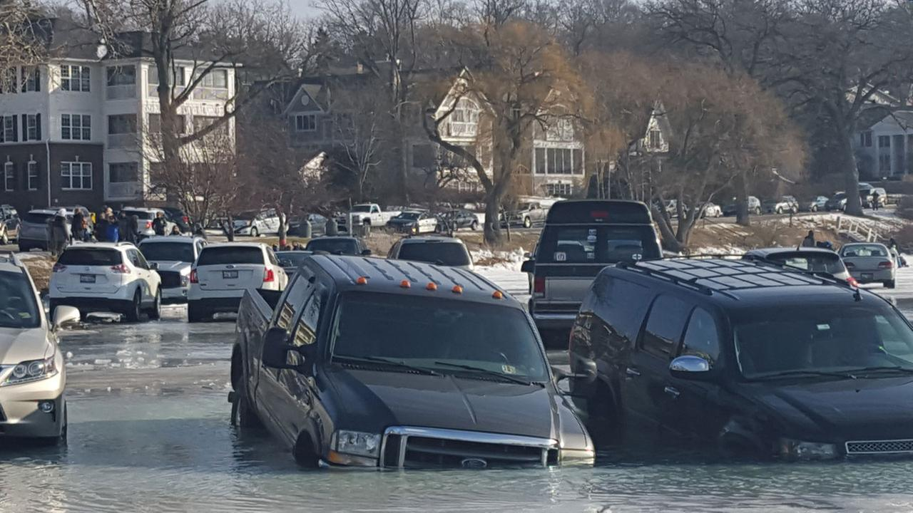 Cars sink through the ice at Winterfest in Lake Geneva, Wis.Lori Gayhart