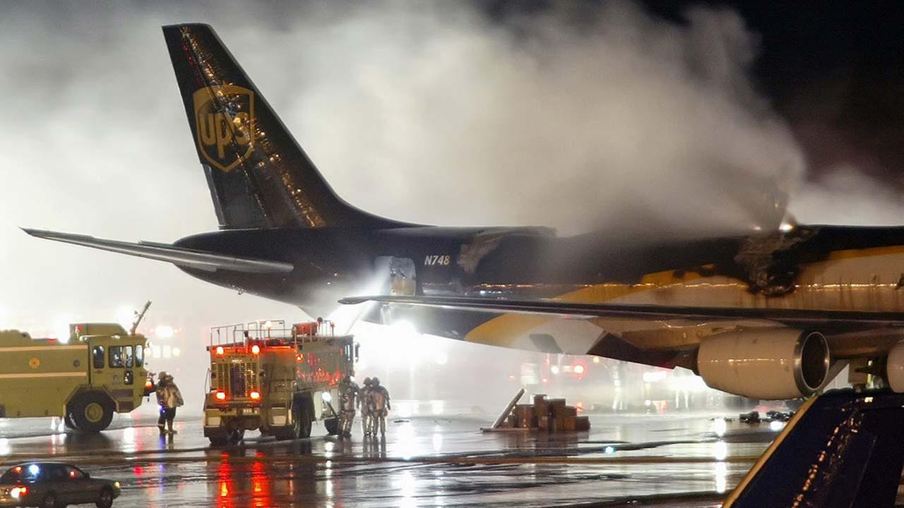 FILE - In this Feb. 8, 2006 file photo, firefighters battle a blaze onboard a UPS cargo plane at Philadelphia International Airport in Philadelphia.