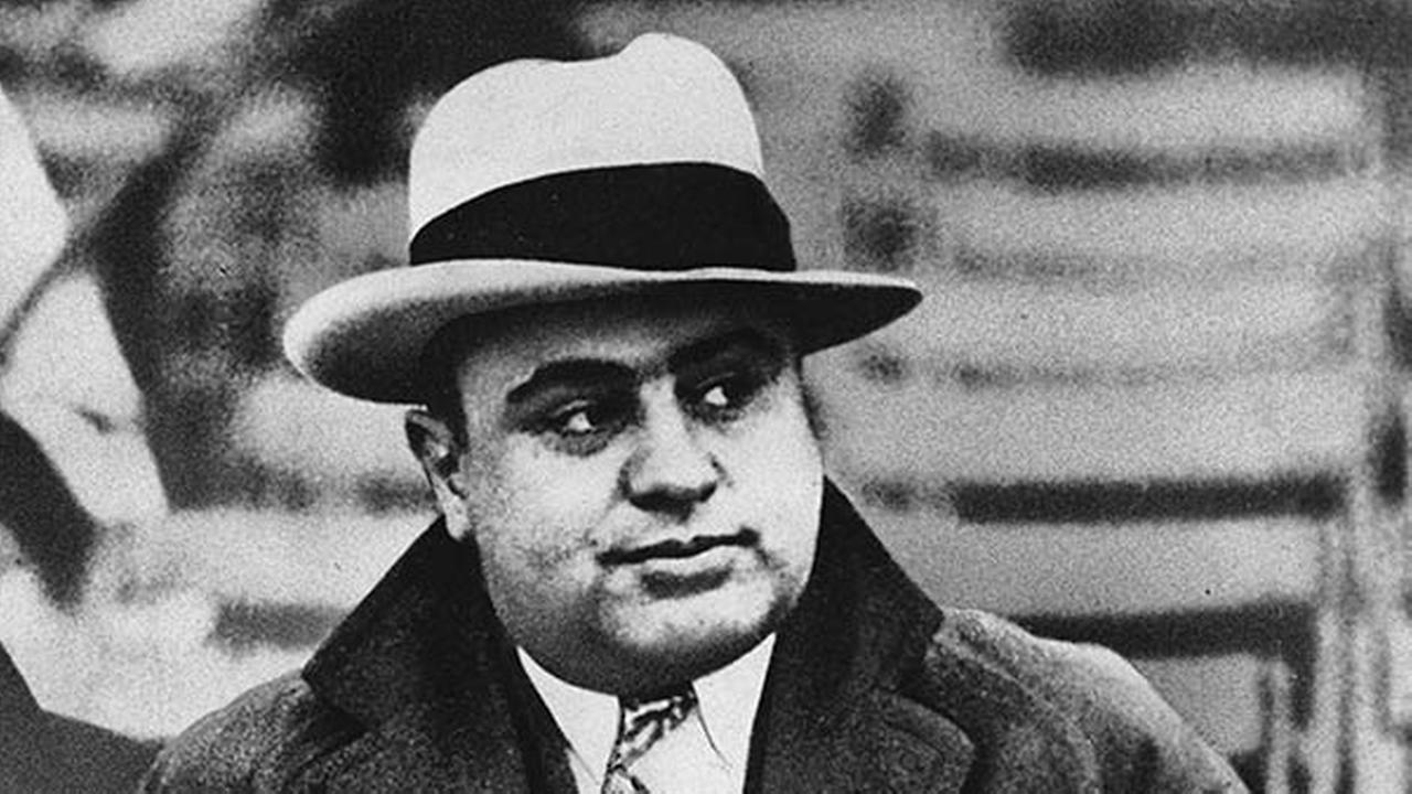 FILE - This Jan. 19, 1931 file photo shows Chicago mobster Al Capone at a football game.