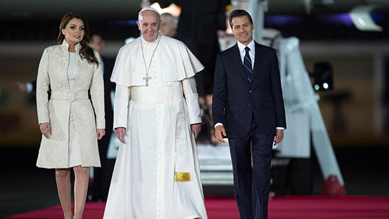 In this photo taken on Friday, Feb. 12, 2016, Pope Francis poses with Mexicos President Enrique Pena Nieto, right, and first lady Angelica Rivera upon his arrival in Mexico City.