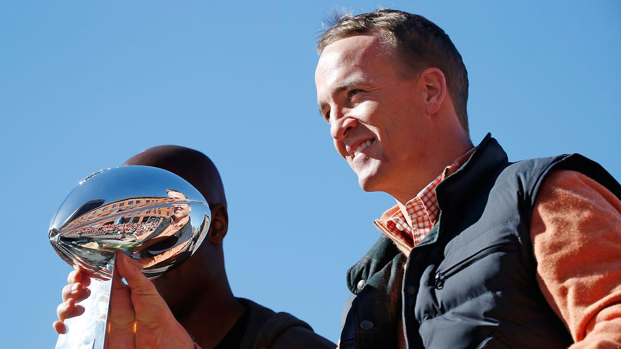 Denver Broncos quarterback Peyton Manning holds the Lombardi Trophy during a parade for the NFL football Super Bowl champions, Tuesday, Feb. 9, 2016, in Denver.