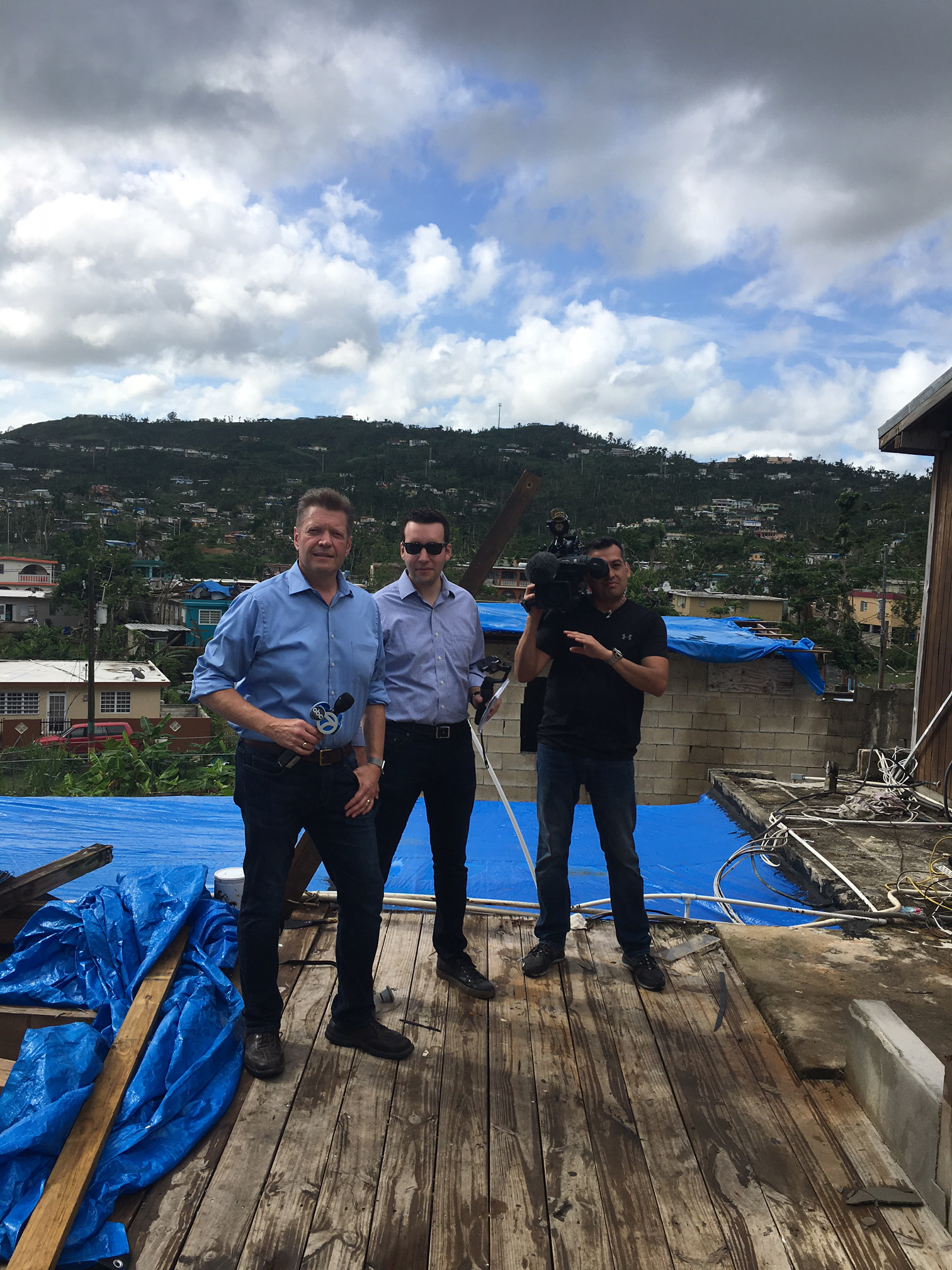<div class='meta'><div class='origin-logo' data-origin='WLS'></div><span class='caption-text' data-credit=''>ABC7 team of Alan Krashesky, Ross Weidner and Jose Sanchez on what used to be the rooftop terrace of a senior center in Galateo, Puerto Rico</span></div>