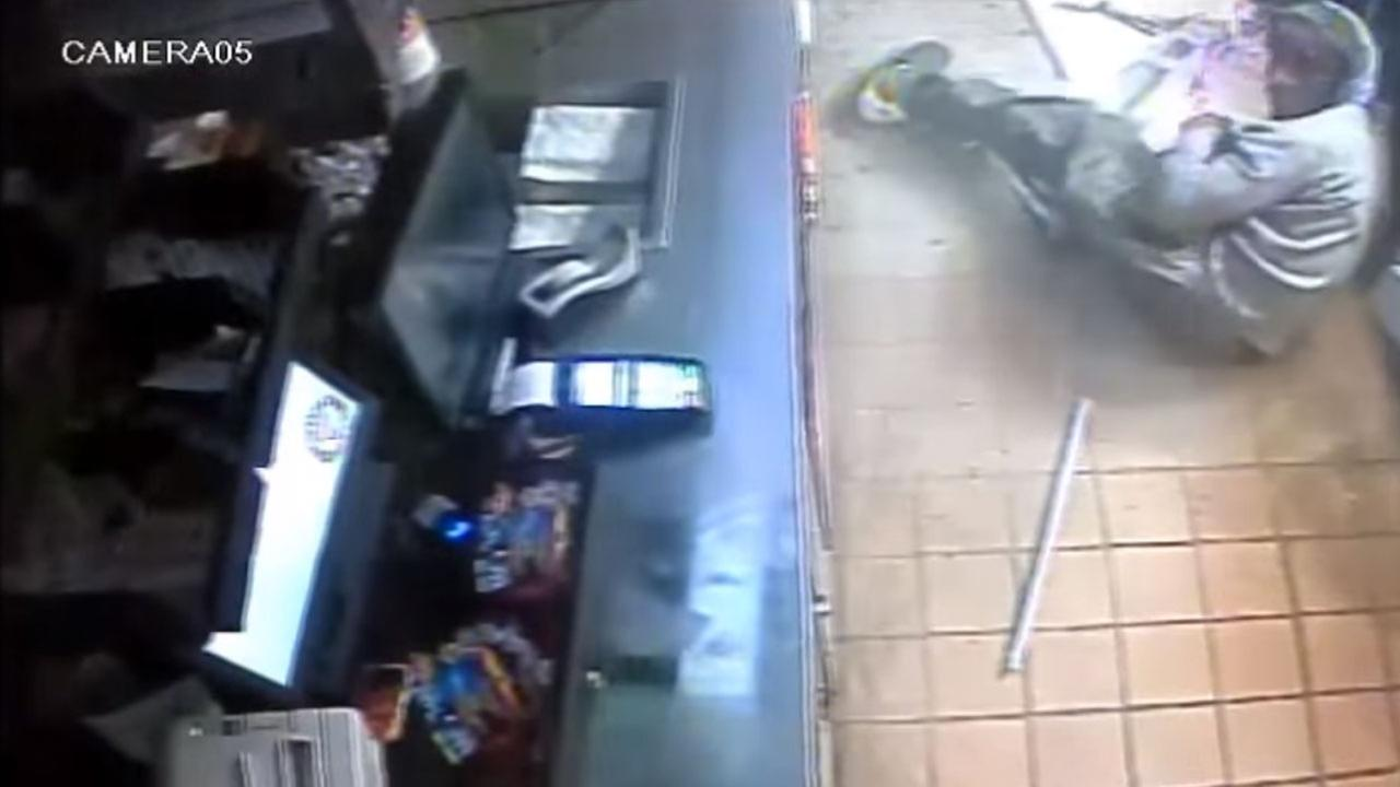 Police are looking for a burglar who was caught on camera falling through the ceiling of a Florida Popeyes restaurant.