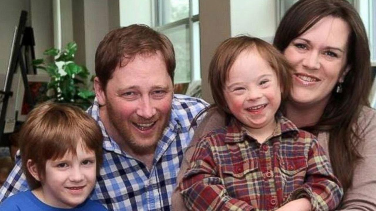 Robb Scott photographed with his wife, Kelly MacIntosh-Scott, and their sons Griffin,7, and Turner, 5.