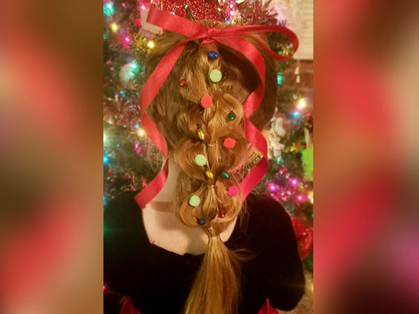 """<div class=""""meta image-caption""""><div class=""""origin-logo origin-image none""""><span>none</span></div><span class=""""caption-text"""">Greg Wickherst styles his daughter Izzy's hair for Christmas. This is the pull through tree. (Greg Wickherst)</span></div>"""