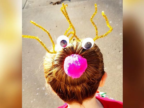 "<div class=""meta image-caption""><div class=""origin-logo origin-image none""><span>none</span></div><span class=""caption-text"">Greg Wickherst styles his daughter Izzy's hair for Christmas. This is the Rudolph bun. (Greg Wickherst)</span></div>"