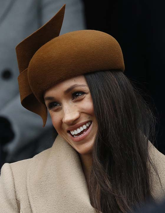 """<div class=""""meta image-caption""""><div class=""""origin-logo origin-image ap""""><span>AP</span></div><span class=""""caption-text"""">Meghan Markle fiancee of Prince Harry smiles as she waits for the Queen to leave by car following the traditional Christmas Day church service at St. Mary Magdalene Church. (AP Photo/Alastair Grant)</span></div>"""