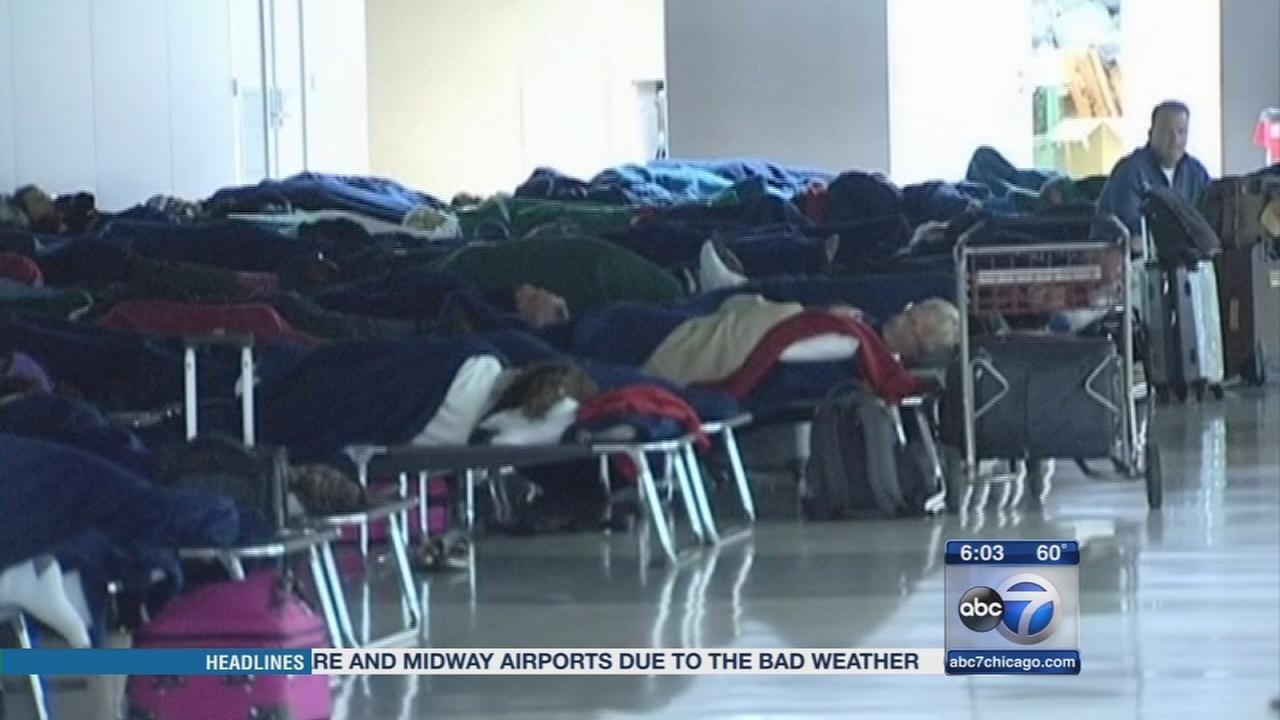Stranded passengers sleep at OHare