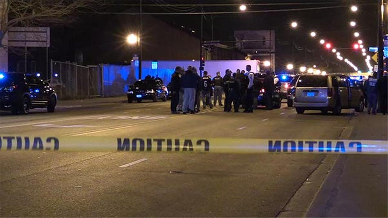 Police investigate the scene where a CPD officer was shot with a pellet gun Friday night/