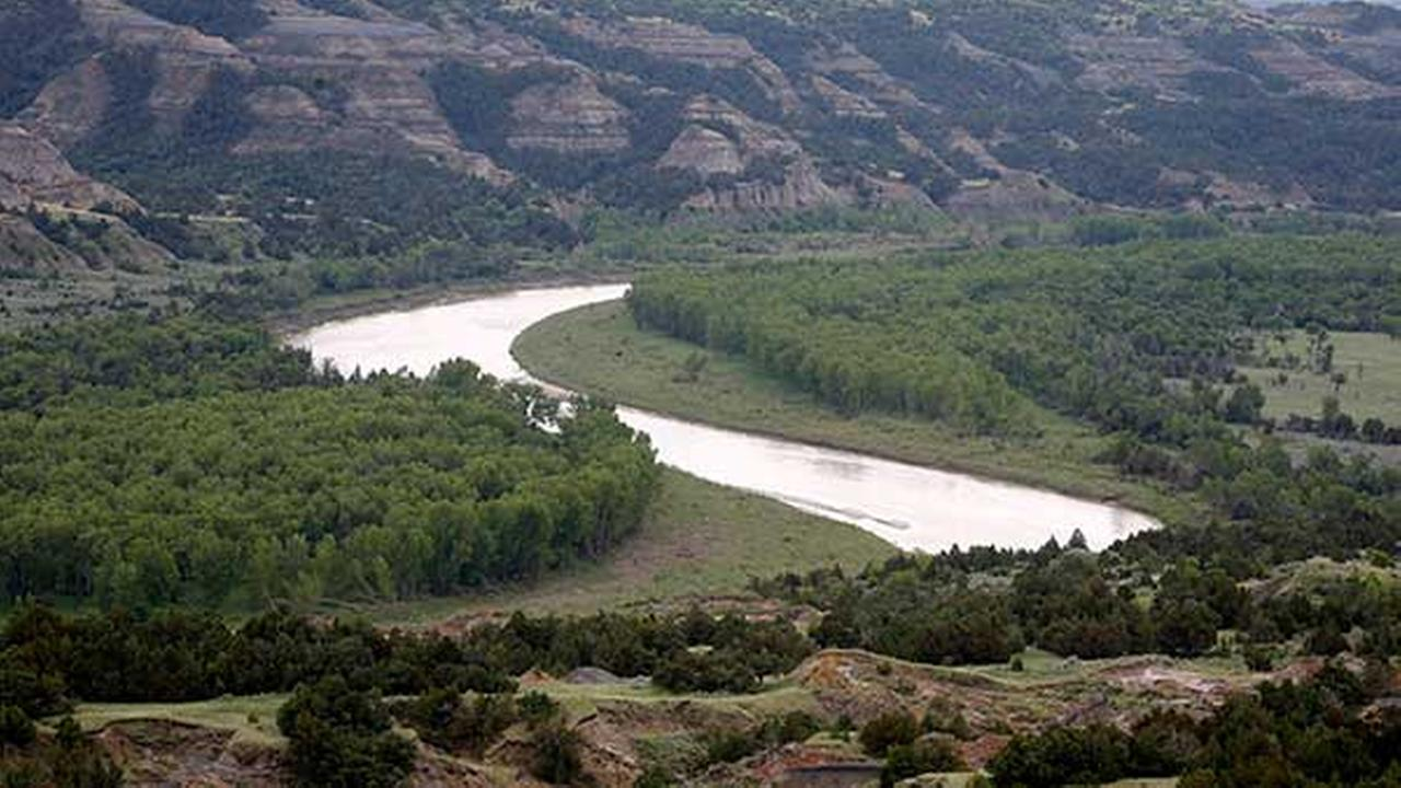 The scenic Little Missouri River winds its way inside the Theodore Roosevelt National Park located in the Badlands of North Dakota on June 11, 2014.