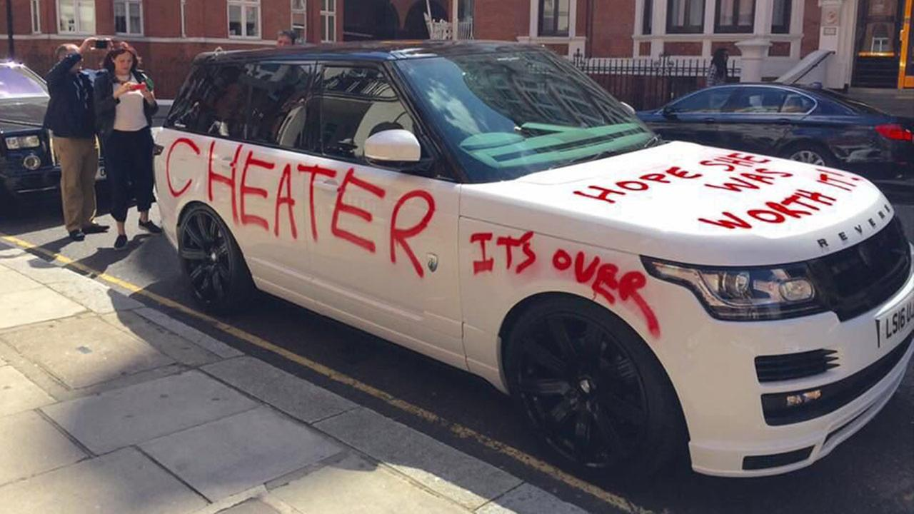 A scorned lover apparently covered a customized Range Rover in angry graffiti.