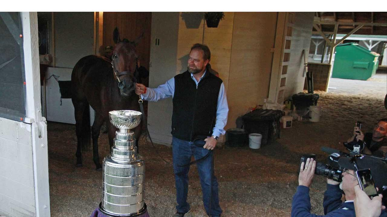Kentucky Derby entrant Nyquist and trainer Doug ONeill pose with the Stanley Cup before the 142nd running of the Kentucky Derby horse race at Churchill Downs on  May 7, 2016.