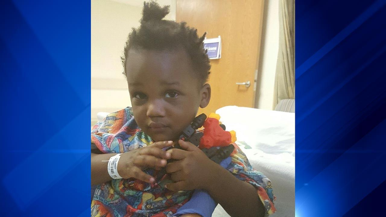 A toddler found in a Stony Island parking lot has been identified and his guardian is with him at the hospital, police say.