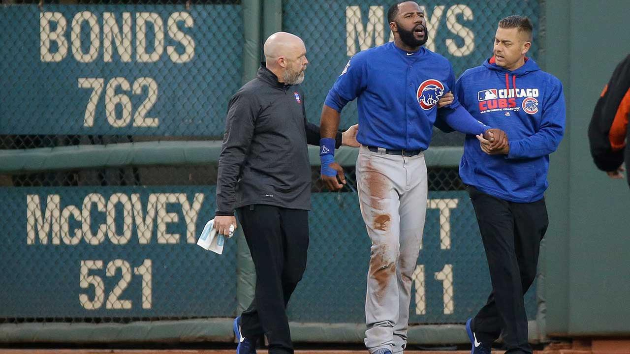 Cubs right fielder Jason Heyward is helped off the field after catching a fly ball hit by San Francisco Giants Denard Span and crashing into the outfield wall on May 20, 2016.