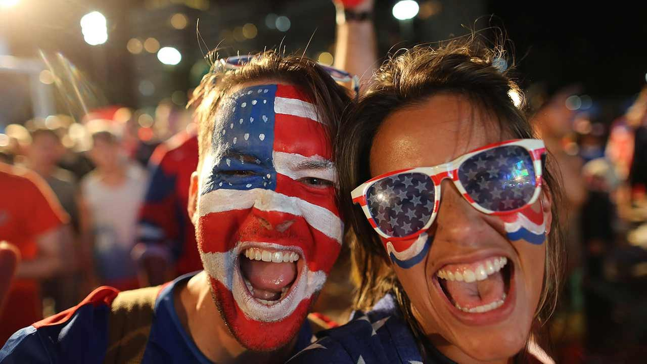 Fans of the U.S. soccer team inside the FIFA Fan Fest area on Copacabana beach before the group G World Cup match between United States and Portugal, Sunday, June 22, 2014.