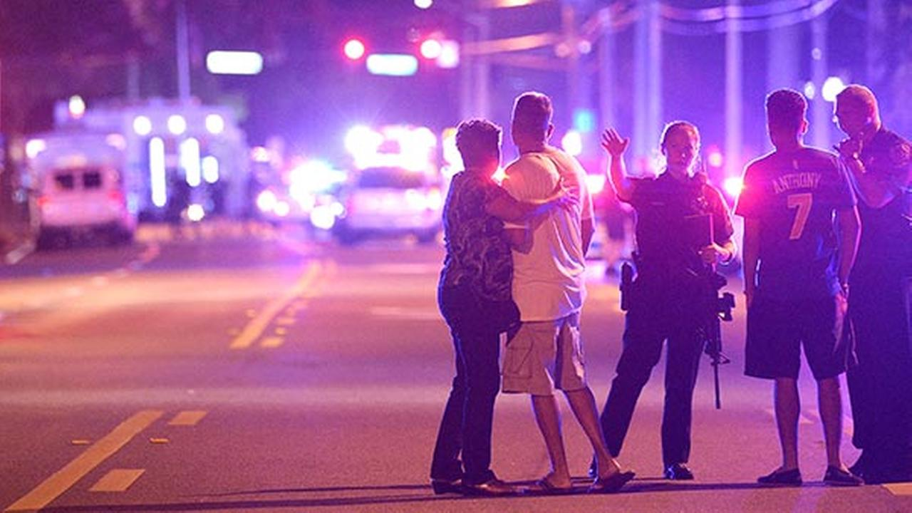 Orlando Police officers direct family members away from a fatal shooting at Pulse Orlando nightclub in Orlando, Fla., Sunday, June 12, 2016.AP Photo/Phelan M. Ebenhack
