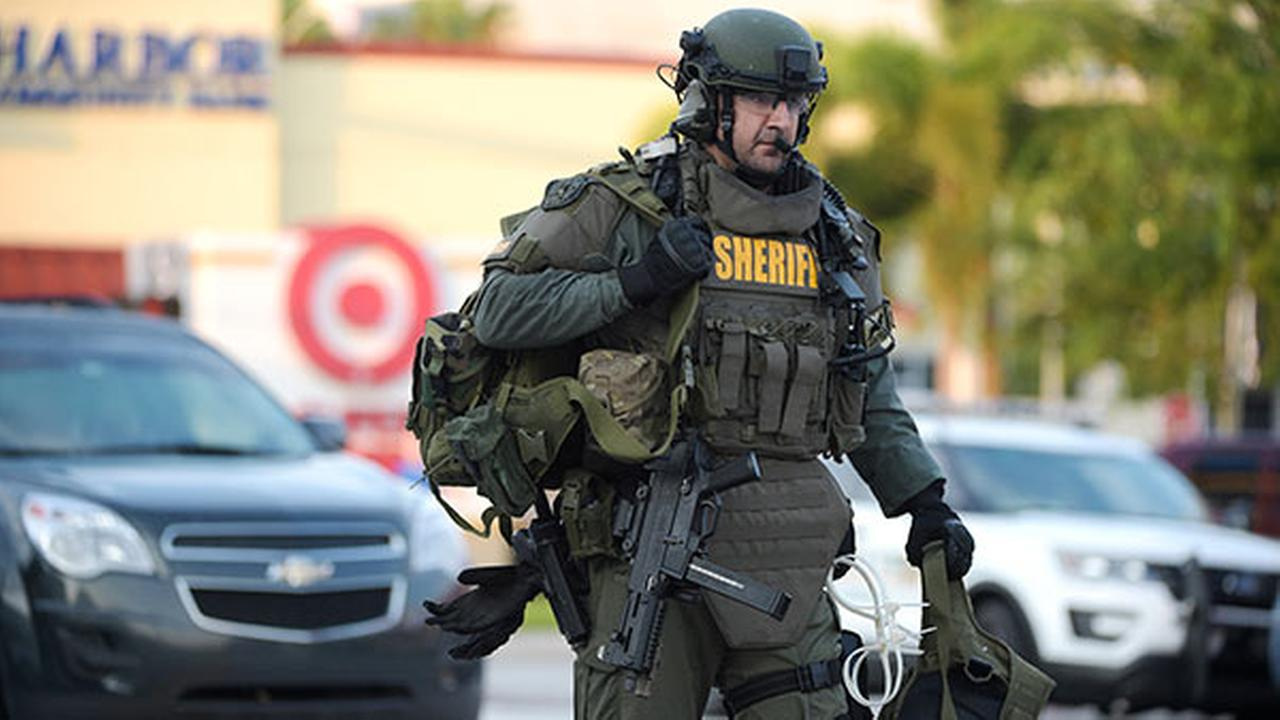 An Orange County Sheriffs Department SWAT member arrives to the scene of a fatal shooting at Pulse Orlando nightclub in Orlando, Fla., Sunday, June 12, 2016.AP Photo/Phelan M. Ebenhack