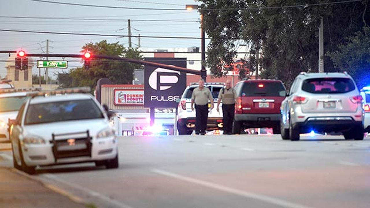 Police cars surround the Pulse Orlando nightclub, the scene of a fatal shooting, in Orlando, Fla., Sunday, June 12, 2016.