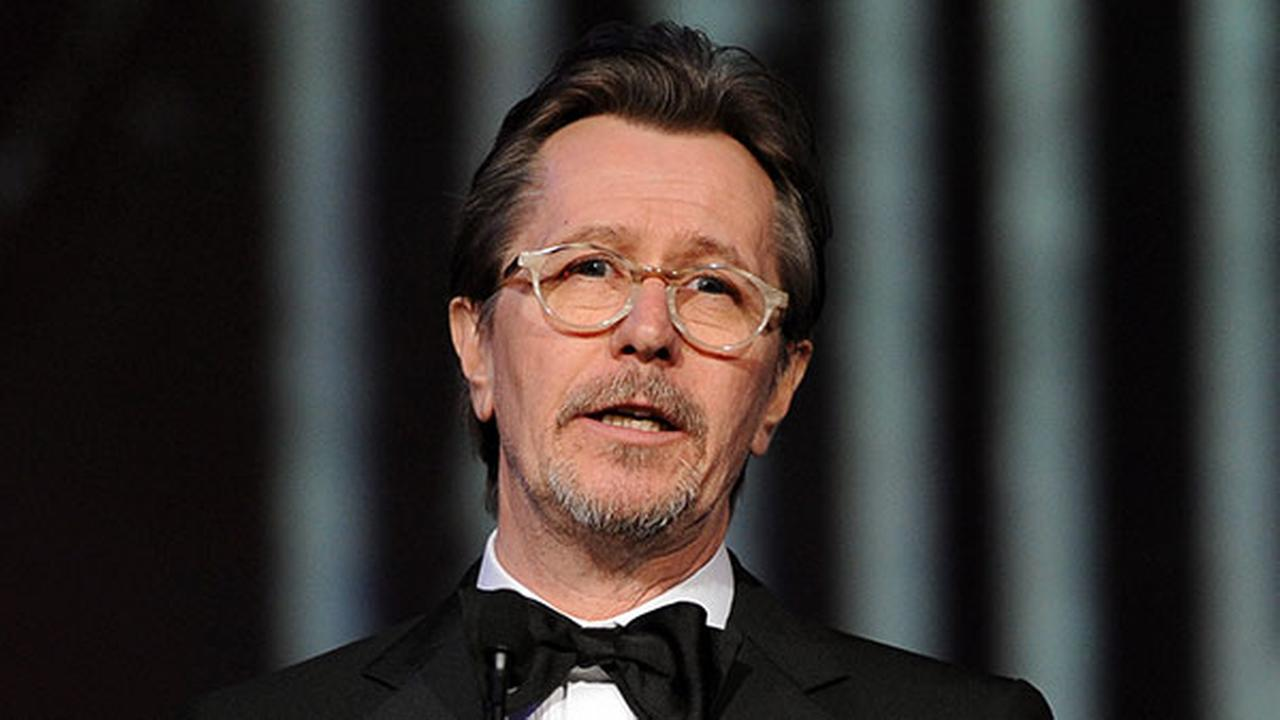 FILE - This Jan. 4, 2014 file photo shows actor Gary Oldman speaking at the Palm Springs International Film Festival Awards Gala.