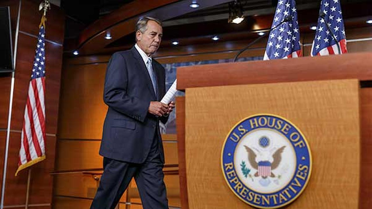 House Speaker John Boehner of Ohio arrives for a news conference on Capitol Hill in Washington, Wednesday, June 25, 2014.