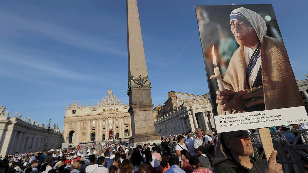 A nun holds a photo of Mother Teresa before the start of the canonization ceremony in St. Peters Square at the Vatican.