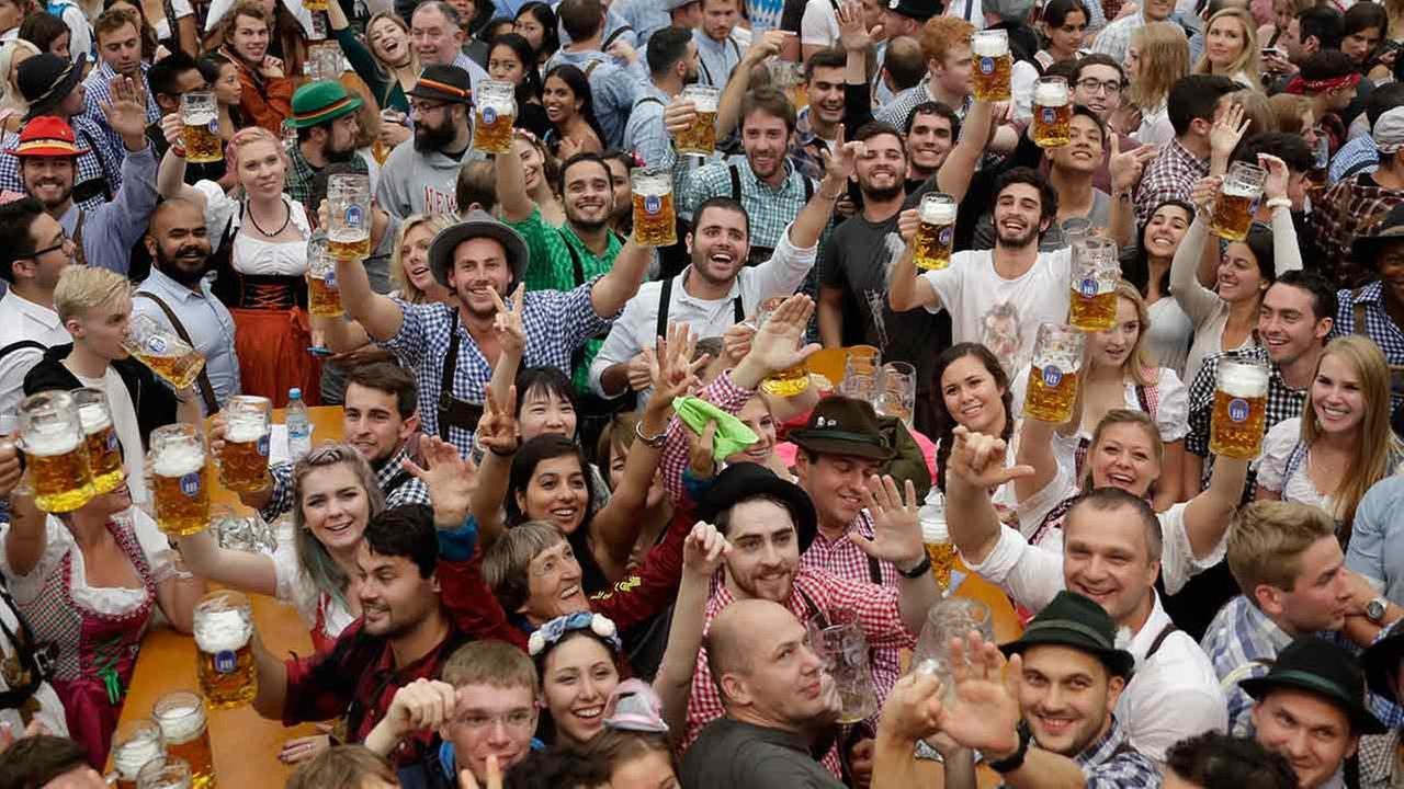 People celebrate during the opening ceremony of the 183rd Oktoberfest beer festival in Munich, southern Germany, Saturday, Sept. 17, 2016.