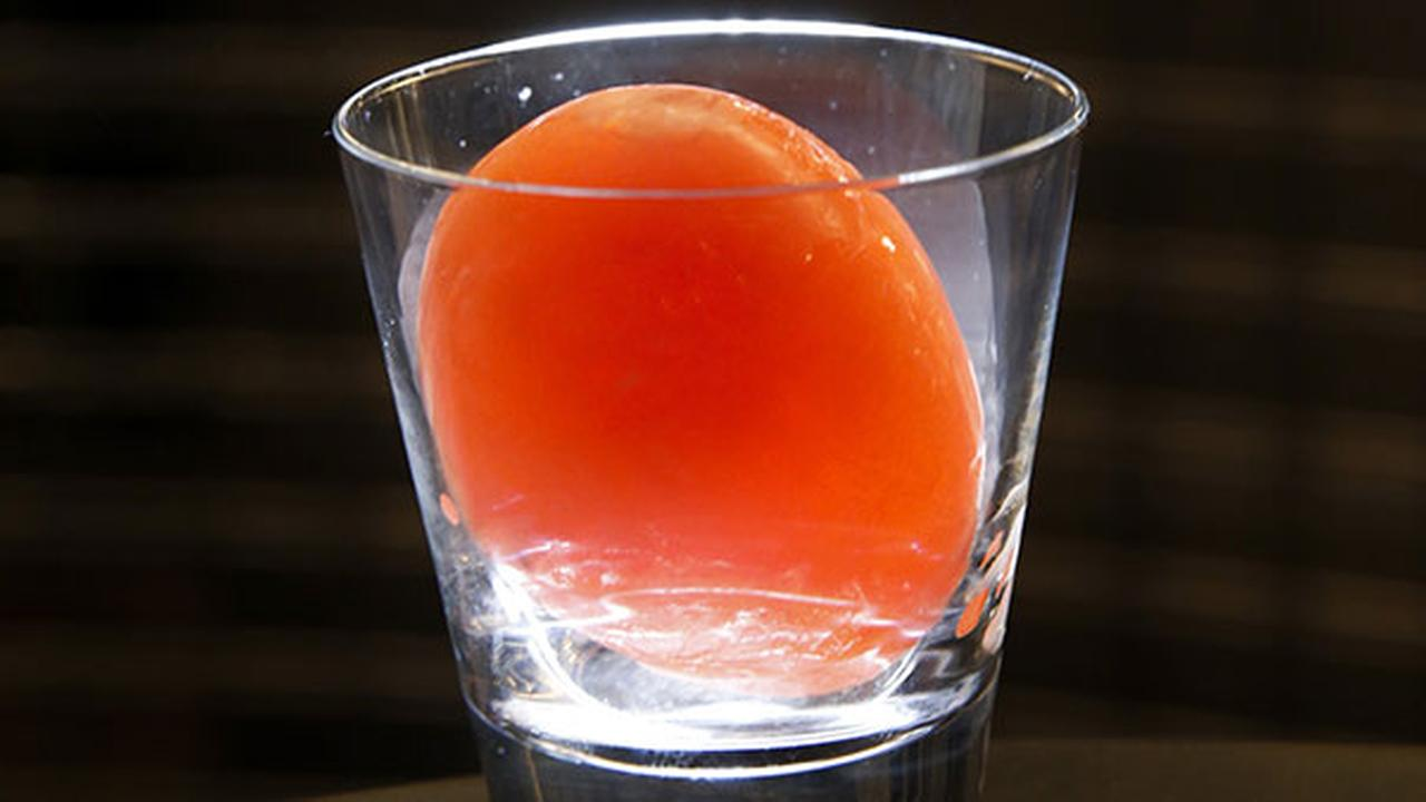 (FILE) The Aviarys signature drink In The Rocks in Chicago. A combination of hollow egg-shaped ice cube and injected cocktail mix, patrons use a sling shot to break the ice.