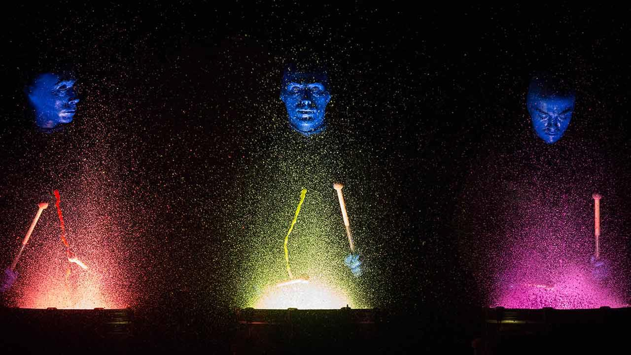 Members of the Blue Man Group perform at the Briar Street Theatre