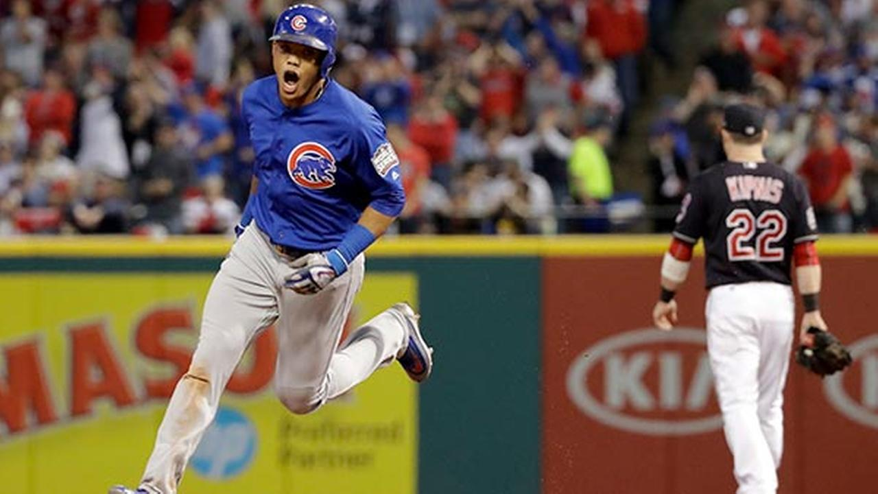 Chicago Cubs Addison Russell celebrates after his grand slam against the Cleveland Indians during the third inning of Game 6 of the Major League Baseball World Series.