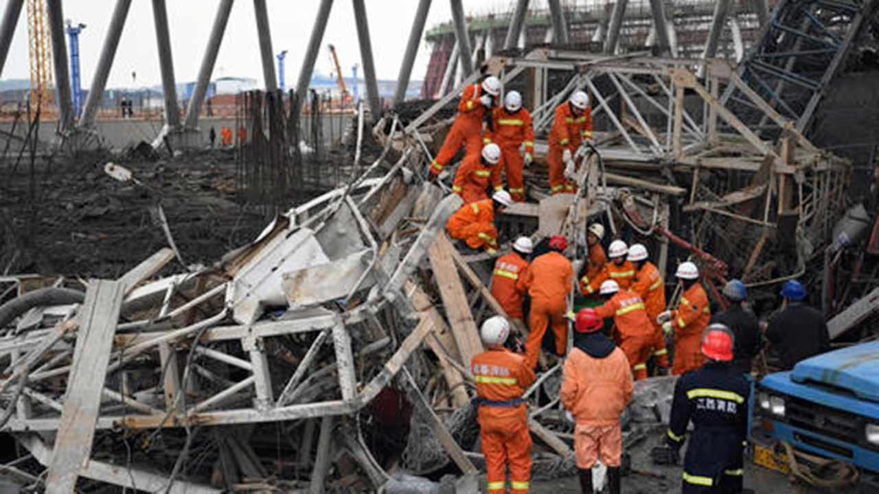 In this photo released by Xinhua News Agency, rescue workers look for survivors after a work platform collapsed at the Fengcheng power plant in eastern Chinas Jiangxi Province