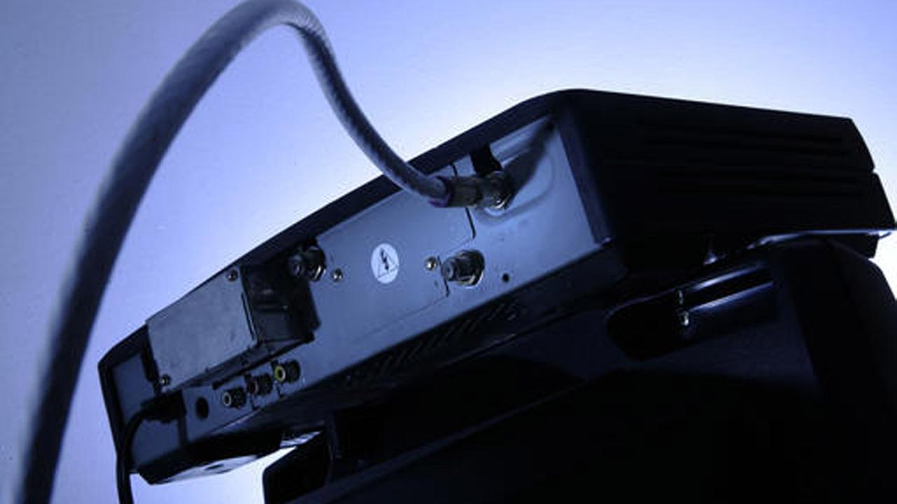 FILE - This Wednesday, May 30, 2007, file photo shows a cable box on top of a television in Philadelphia.