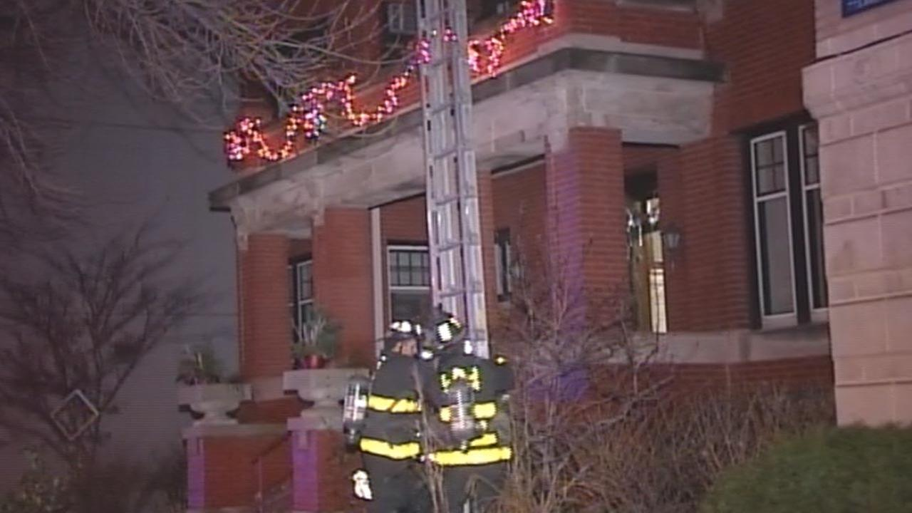 Firefighters battle an extra-alarm blaze early Sunday at a three-story building in the 500-block of West Wellington.