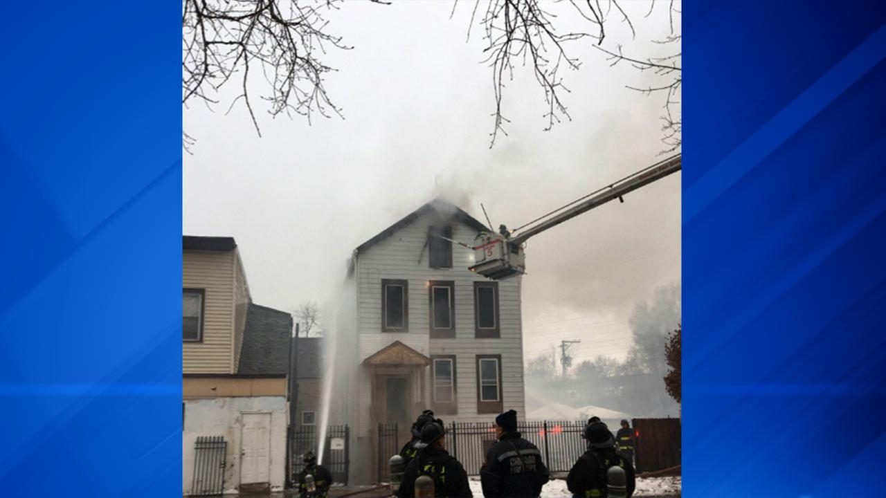 Firefighters fight a blaze Sunday morning in the East Side neighborhood on the Far South Side.
