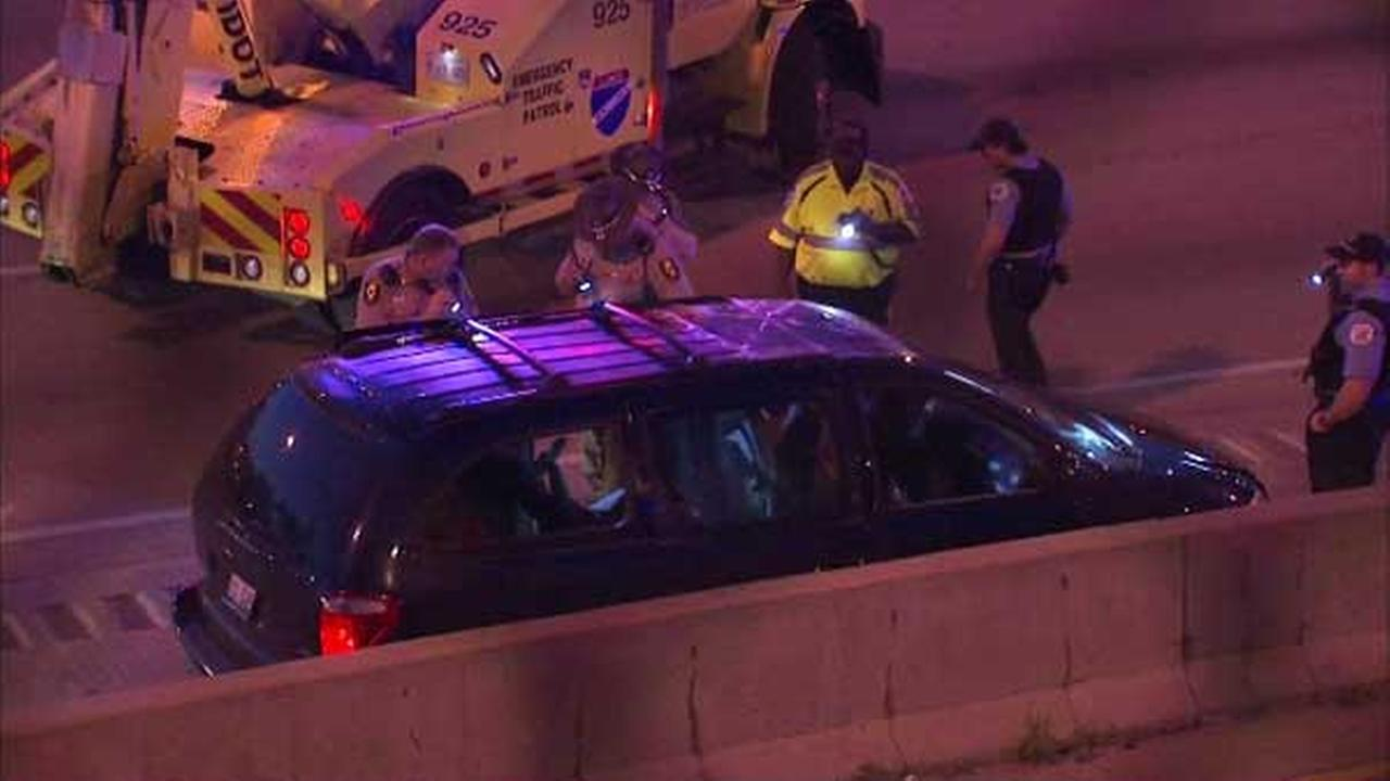 Police investigate a fatal shooting on the outbound Dan Ryan Expressway near 59th Street.
