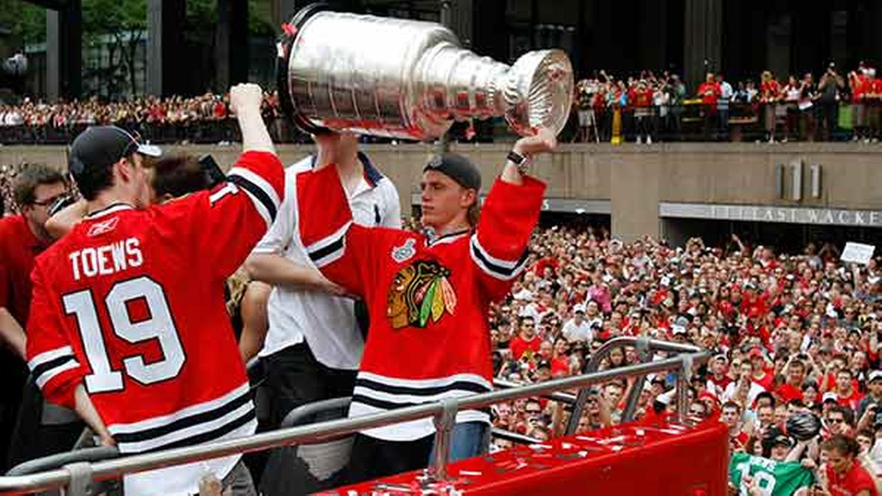 Chicago Blackhawks Patrick Kane, right, holds the Stanley Cup as Jonathan Toews looks on during a parade to honor the 2010 Stanley Cup championship in Chicago on June 11, 2010.